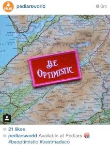 be optimistic badge