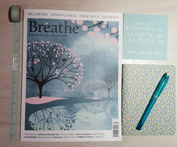 breathe magazine blue flatlay